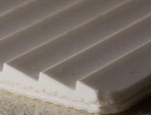 Двухслойная транспортерная лента ПВХ пищевая с с зубчатой рабочей поверхностью с s- 4 мм, Ду вал 60 мм.